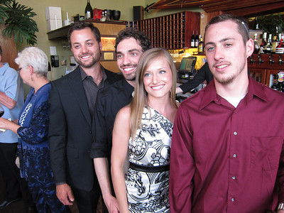Kelly & Beto with her big brothers Eric, left, and Jason.