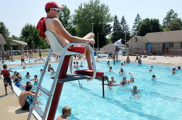 Lifeguard Nathan Powell watches swimmers from his perch as more than 200 people beat the heat by spending their afternoon at Beulah Park in Alexandria. The area set a new record for the month of June at 104 degrees, according to the National Weather Service.