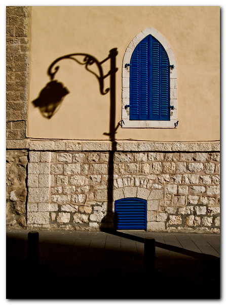 Shading Light:<br /> <br /> A street light reflects on the wall of the Italian building, biankiny St', Jerusalem.