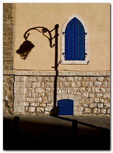 Shading Light:  A street light reflects on the wall of the Italian building, biankiny St', Jerusalem.