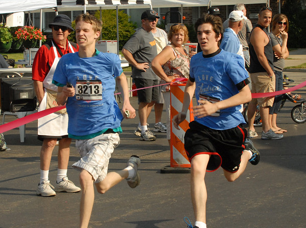 Runners sprint for the finish line.