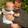Tyler Voss holds his 11-month-old son Noah during the benediction at the For the Love of Andrea 5K Run and Walk Saturday morning at the First United Methodist Church in downtown Pendleton. Over 750 runners and walkers participated in the event that was for Andrea Vellinga who was injured last August during the stage collapse at the Indiana State Fair.