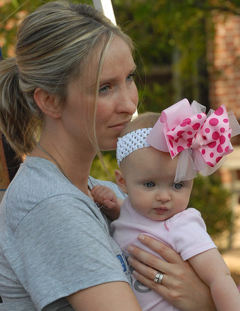 Amy Lukens holds her six-month-old daughter Ella Grace at Saturday's Big May 5K.