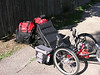 My ICE QNT trike.. loaded up to go on a tour.   No Radio stuff on it at this time though...<br /> My plans are for either my FT-817 and HFpackAMP to go into the 'bar bag' on the side mount  with battery in either one<br /> of the seat side bags or one of the red bags.  Or mount the an IC-703 'body'  in a box on the rack with battery  and put the control<br /> head on the bar-bag.  Not sure what I am going to do for antenna yet.  I have several antennas to choose from. Hamsticks,  Buddie stick or pole, outbacker (belongs to my dad)  or a small motorized screwdriver antenna.  Worried a bit about vibration on that last one..