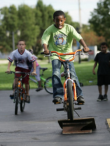 Antonio Ball goes off the home made bike ramp at Spencer Warner's birthday part Sunday. He is followed by Anthony Arnold, age 10, of Lorain and watched by Andre Coles, age 11 of East Liverpool, OH. photo by Ray Riedel