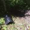 "From Bill:<br /> Our progress on the septic system is slow--very slow. It's just a miserable task. I think the worst I've done here. We have 6 of those long black sections to bury with 6"" of soil on top. They are bigger than they look in the picture. The digging is very slow going. And where you have ""soil"" it's clay that is so sticky it is essentially glued to your shovel with each shovel full. You need to use another shovel to dislodge each shovel full. We also need to figure out how to get out tank about a foot lower than grandpa's old one. <br /> <br /> But my boat project turned out super. See pictures."