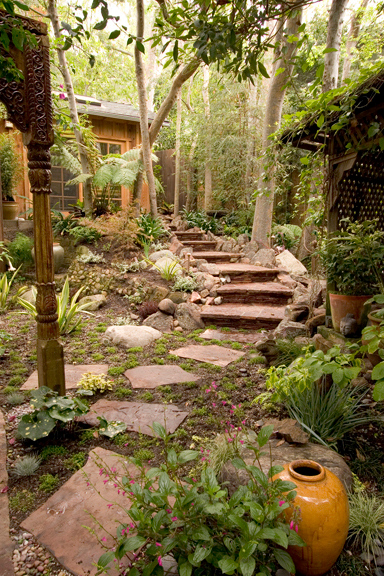 "<h2 class=""notopmargin"">About Sacred Space Garden Design Inc.</h2>  <p>Karen Miller, now the principal designer and managing partner, founded Sacred Space Garden Design in 2002.</p>  <p>Her background before landscape design was in commercial photography and her career spanned over 25 years. Specializing in the music industry, shooting album and magazine covers, special promotions and endorsement advertising, she traveled all over the world and enjoyed her work immensely.</p>  <p>When the music industry began to change drastically, she realized that it was time to reinvent herself. However, instead of pursuing a different style of photography, she chose to pursue a completely different career path. She studied at UCLA Extension through the Gardening and Horticulture program, crossing over in to Landscape Architecture studies as well. After apprenticing with other landscape design/installation companies, she launched Sacred Space Garden Design.</p>  <p>In her new business, she found that her skills as a visual artist translated extremely well in to the landscape. Spatial and color relationships, lighting, lay out and creating unique visual interest were all skills that she had spent the last 25 years honing. Working with outside vendors who bring additional skill sets to complete the project was also very familiar.</p>  <p>Today Sacred Space is a family run business, bringing a collective 40 years of experience together. Working regularly with a tight knit group of artisans who take great pride in their work and strive for the highest results, they find great inspiration in the knowledge that they are able to help people transform the way they use and enjoy their outdoor space.</p>"