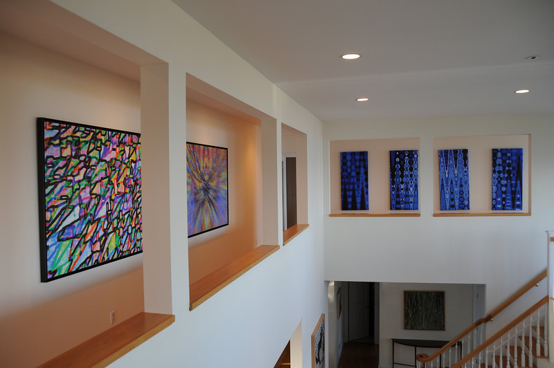 "This is a private collection featuring four prints (three visible here).  The four panels on the right side are ""one"" piece of art that is was done on four panels to expand the art to fill an entire wall."