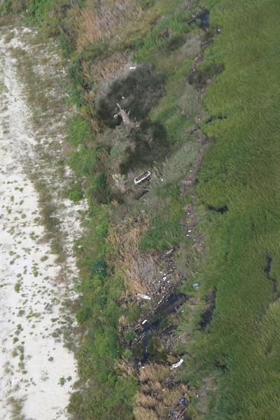 Trash at high tide/storm tide line on Quarantine Island.