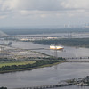 Jacksonville Port Authority Blount Island on the left.  Dames Point Bridge background left.  Jacksonville downtown background right.