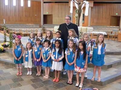 Bishop Olson presents Catholic Scouting emblems