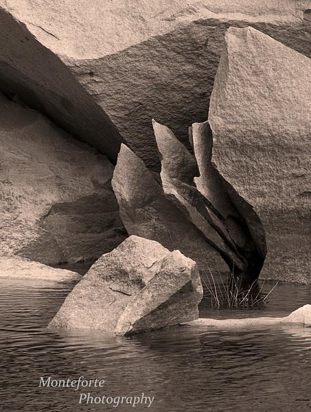 Fractured rock in Merced River in sepia tone, Yosemite NP.