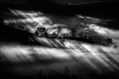 Surise thru the foggy hills.