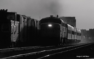 Via passenger extra leaves London, Ontario eastbound with a pair of FPA4 locomotives near sunset in 1979.