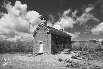 "Black and white version of the Grafton Ghost Town School House.  I really couldn't ask for prettier clouds and was loving the gorgeous sky this day.  This same ghost town was featured in the movie ""Butch Cassidy and the Sundance Kid"" as the location where they rode the bicycle.  It's just outside Zion National Park."