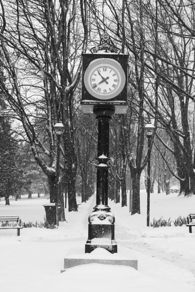 Antique clock in the snow.
