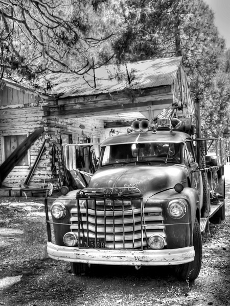 Old tow truck and gas station off of Highway 70 in California