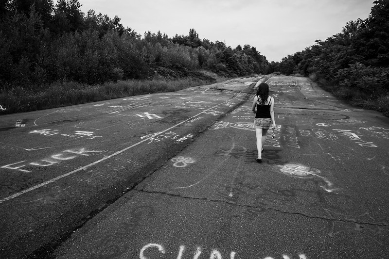 A girl, aimlessly wandering in a post-apocalyptic world.