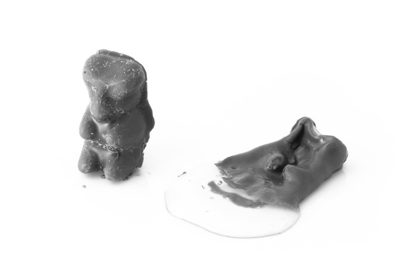 """<span id=""""date"""">_11/04/10_</span> <span id=""""title"""">Melty Death</span> Pictured here are two chocolate-covered gummi bears. Can you tell which one spent 10 seconds in the microwave? After I was satisfied with the result I ate the subject, but I must warn you: gummi bears don't revert back to the same consistency after they've cooled. It was like eating rubber cement and spiderwebs. Also, thanks for the kind comments on yesterday's shot - isn't it funny how the spontaneous ones are always the best?  <a href=""""http://www.jawsnap.net/Daily/year2/7157835_BfJPF#703630904_AgaRA"""">[last year]</a>"""