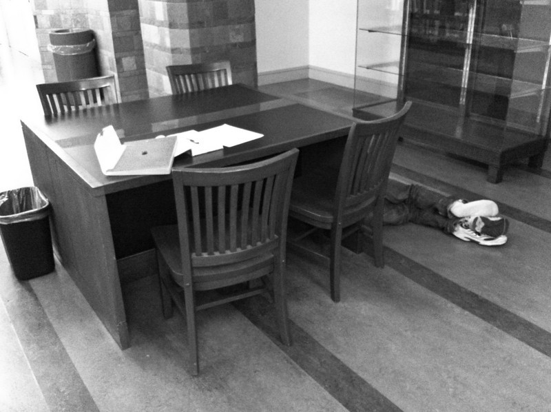 """<span id=""""date"""">_07/15/10_</span> <span id=""""title"""">Study Break</span> I was walking through the library today and I couldn't pass up a photo of this. There are plenty of comfy chairs and benches... I guess this guy prefers the floor. This is one of many iPhone photos I shot today. I've been shooting groups of three using the 3G, 3Gs and 4 to compare the cameras. Obviously the 4 has the best camera, but I thought it'd be nice to see some side-by-side comparison. Stay tuned for the results!  <a href=""""http://www.jawsnap.net/Daily/year2/7157835_BfJPF#592374620_Vd9Ed"""">[last year]</a>"""