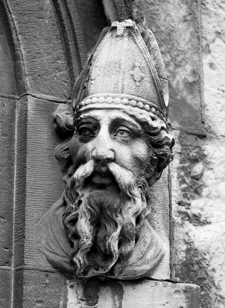 St. Patrick, or Naomh Padraig, is a patron saint of Ireland. This stone carving is on the outside of the entrance to the Cnapel Royal in Dublin.