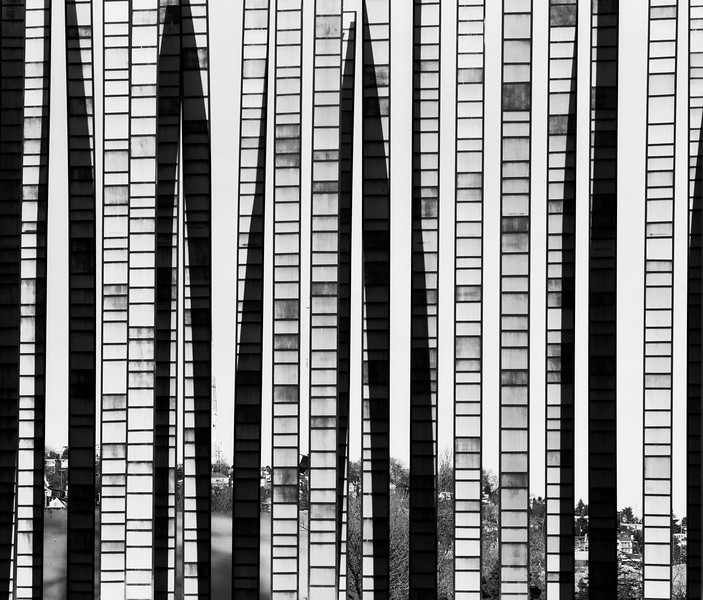 A small portion of a glass installation with a part of Queen Anne Hill in Seattle visible along the bottom. (Scanned from black and white film.)