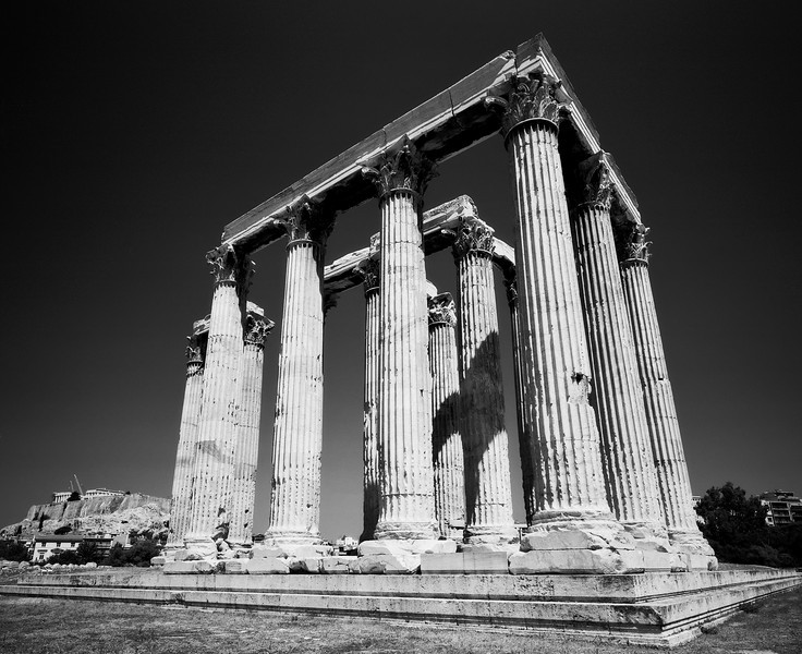 The Temple of Zeus in Athens, Greece with a glimpse of the Parthenon and the Acropolis at the lower left edge. (Scanned from black and white film.)