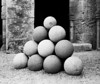 A stack of stone missiles that were once fired from catapults into the city of Rhodes during a siege. (Scanned from black and white film.)