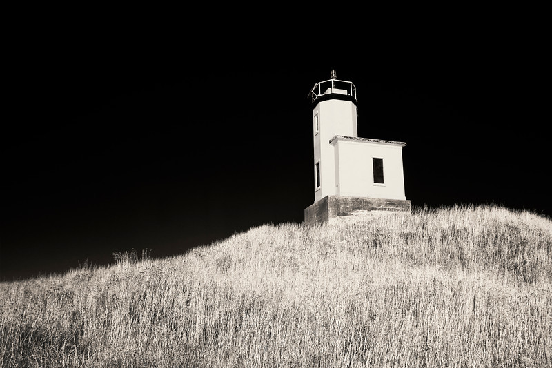 The lighthouse on Cattle Point on San Juan Island in Washington State stands on top of a small hill.  (In black and white from a camera converted to infrared.)