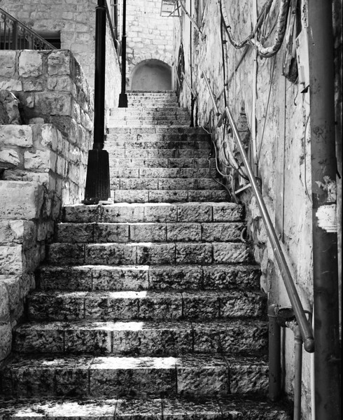 An empty stone stairway in the historical section of Zefat, Israel. Zefat (or Safed or Tzfat) has been considered one of Judaism's Four Holy Cities, along with Jerusalem, Hebron and Tiberias. The city has remained a center of Kabbalah, also known as Jewish mysticism.
