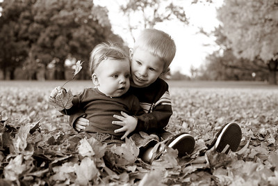 He is sooo sweet with her. love this style which is brown/black and white. She was into the leaves big time.