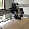 The machine goes down to the end of the table and selects the appropriate cutter, or router bit.