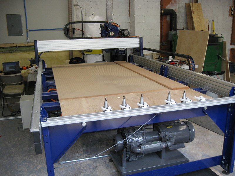 The primary tool of MCW Inc. is a computer numerically controlled machine, with the commercial name ShopBot, standing for shop robot.  It is a little bigger than a Ping-Pong table.