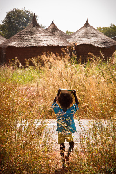 Little boy carries a bowl of local porridge home to his village in Bougouni, Mali. Although a number of public policies demonstrate the government's willingness<br /> to assist the poor and the vulnerable, poverty alleviation programs may not be effective<br /> and the social safety nets remain minimal compared to the needs. Nutritional indicators are of particular concern in Mali, as 81 percent of children<br /> have some form of anemia and 38 percent of children under 5 years old show significant<br /> levels of stunting and wasting.  (World Bank)