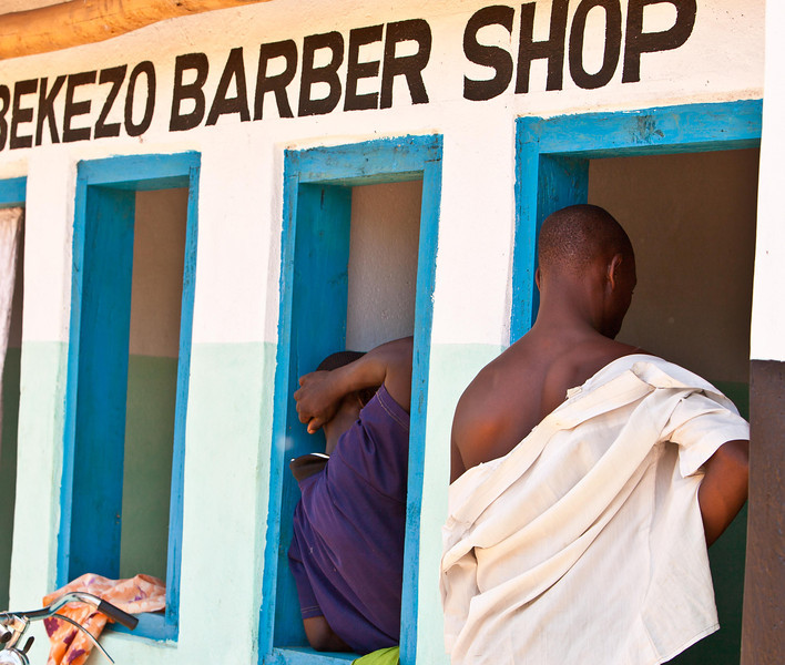 The barber shop serves as a sort of men's club in Malawi, a man's world where women are expected to be submissive.  HIV affects a disprortionate number of women and children.