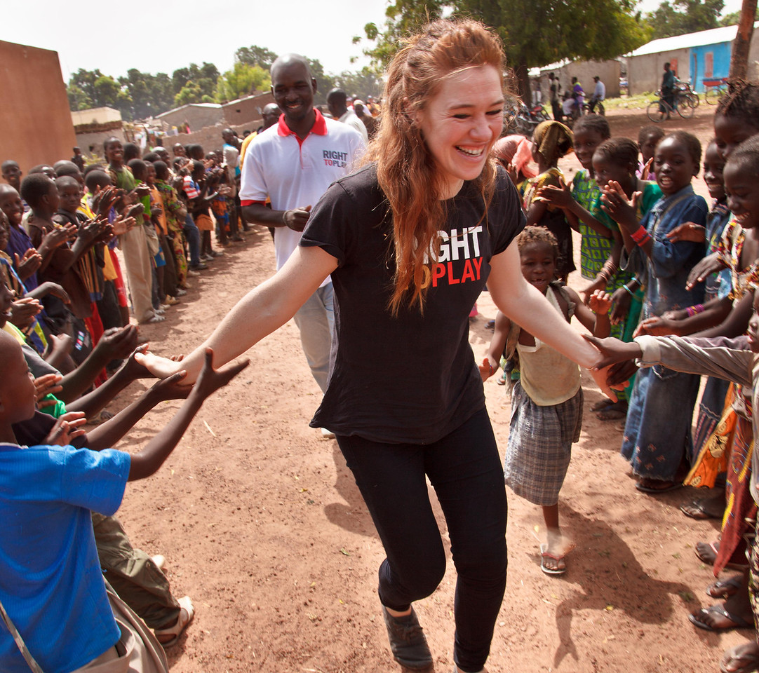 """Clara is welcomed by a corridor of children chanting """"Right To Play"""" in remote Ouroun, Mali"""