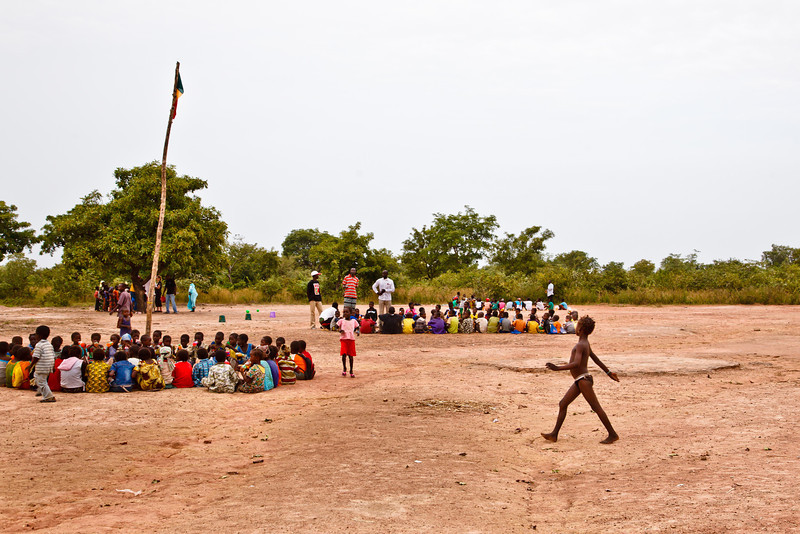 Children participate in a RTP game in Bougouni, Mali. Mali has a high level of poverty and social indicators remain among the lowest in<br /> the world. Almost one in two Malians is poor; most of the poor live in rural areas, are<br /> illiterate, and earn their living from subsistence farming. Demographic pressure contributes<br /> to poverty aggravation and based on various reviews and studies, Mali will not be able to<br /> reach the Millennium Development Goals by 2015. (World Bank).