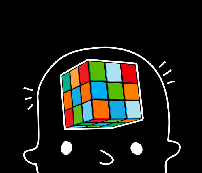 The boy is thinking in his head touch cube