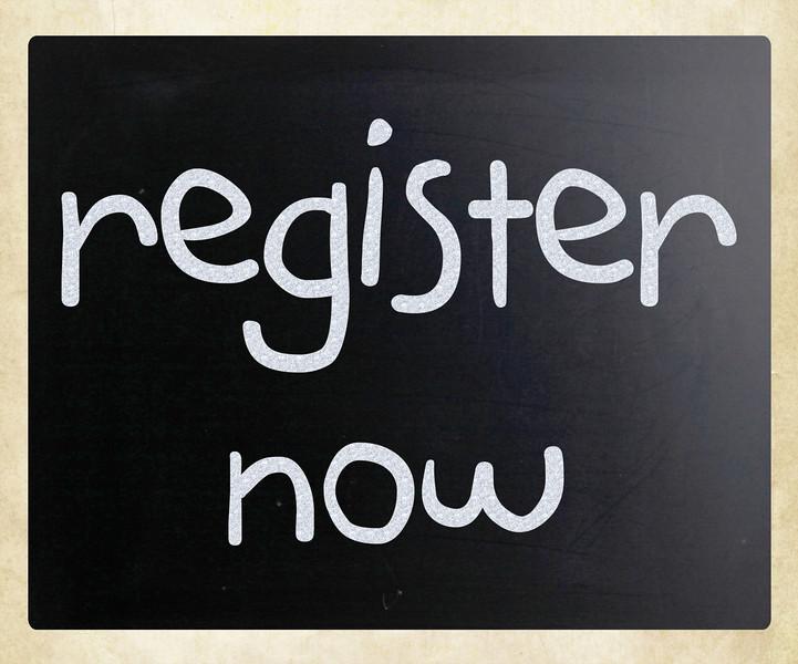 """Register now"" handwritten with white chalk on a blackboard"