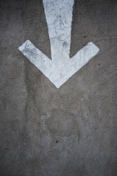 Drawn arrow on a lane.