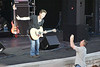 "Captures from the Richard Marx concert at the Sandy Amphitheater.  He put on a good concert with good audio production and really good audience involvement.  He said entertainers want to have their picture taken so he doesn't have a no-picture policy during the show.  As he said that, this guy ran down like it was ""The Price is Right"" and he had won the Showcase Showdown.   Richard Marx poises for a picture."