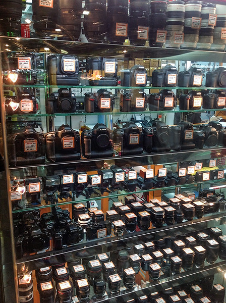 second hand cameras and lenses on display in a shop inside Sim City, in Mongkok, Hong Kong