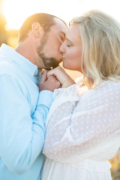 Engaged Couple Kissing at Sunset
