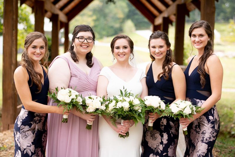 Bridesmaids under Covered Bridge