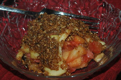 June 21, 2009 While we waited for the lasagna bites to warm, we had a strawberry and apple cobbler that was made from the leftover fruit used at breakfast.  The topping is granola-based.  Quick and easy.