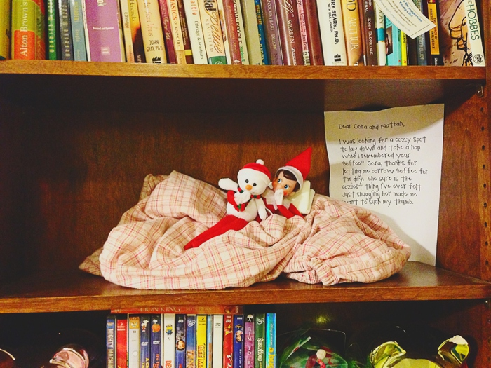 Elf borrows the special blanket to snuggle, Elf on the Shelf ideas by Carey Pace