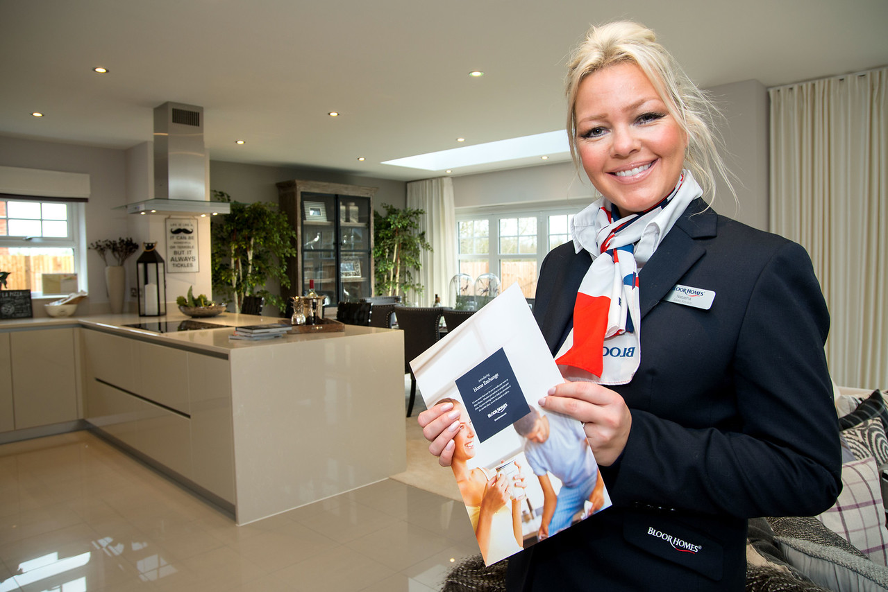 Bloor Homes shoot - Mayfield Place Development, Winkfield, Windsor - Bloor sales advisor Natasha Seaborn-Davis in the Kitchen/Diner/Seated Area of the show house, with the company's leaflet promoting a part exchange. - Picture Andy Brooks - 1st February, 2016.