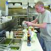 Head Chef Dave Thielmann works in the kitchen. SENTINEL & ENTERPRISE/ JOHN LOVE