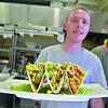 Head Chef Dave Thielmann shows off some fish tacos. SENTINEL & ENTERPRISE/ JOHN LOVE