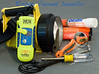 Photo by Vincent Daniello. In addition to required equipment like flares and important extra gear like this Personal Locator Beacon, ordinary equipment becomes vital gear in emergencies--a sharp knife to cut tangled lines or a snagged anchor, a good flashlight and mechanics mirror for peering into problem areas, and a nutdriver to quickly tighten loose hose clamps.